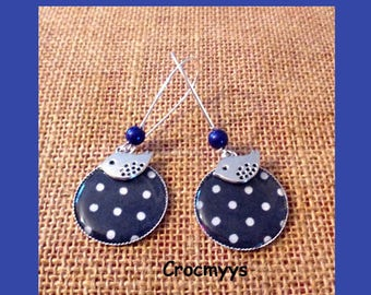 Large blue earrings with polka dots