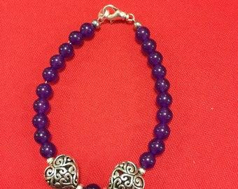 Purple beaded filigree heart bracelet