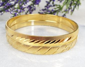 Vintage Signed Monet Set of 2 Gold Textured Patterned Stacking Bangle Bracelets