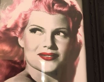 Rita Hayworth pink hair print in a black frame 7x5""
