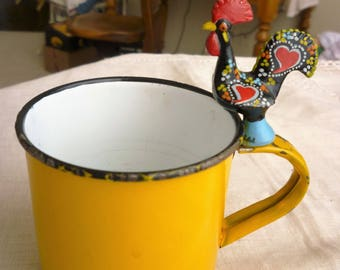 Golden Yellow Enamelware Cup, and Good Luck Rooster made of Metal and Painted, Portugal printed at base.