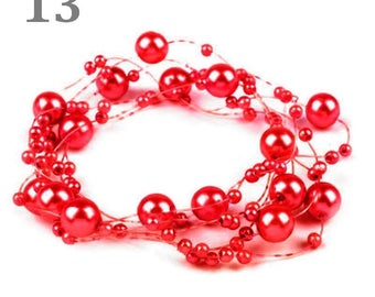 Wreath adorned with pearls red 130 cm