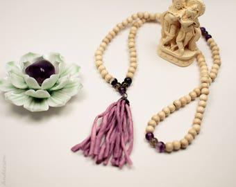 White wood, Flourite, Smokey Quartz 108 bead mala with gunmetal accent and pink silk tassle.