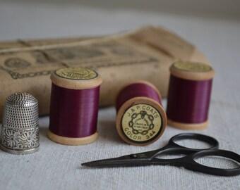 12 antique Victorian spools of sewing thread 1880s Plum colour