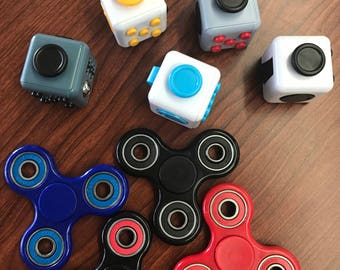 Monogrammed fidget cubes and spinners