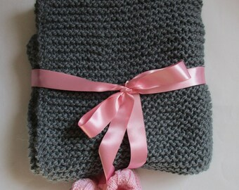 Grey baby blanket and pink slippers with alpaca and wool