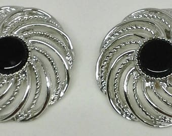 Vintage Sarah Coventry clip on earrings, pinwheels, flower design silver plated black center