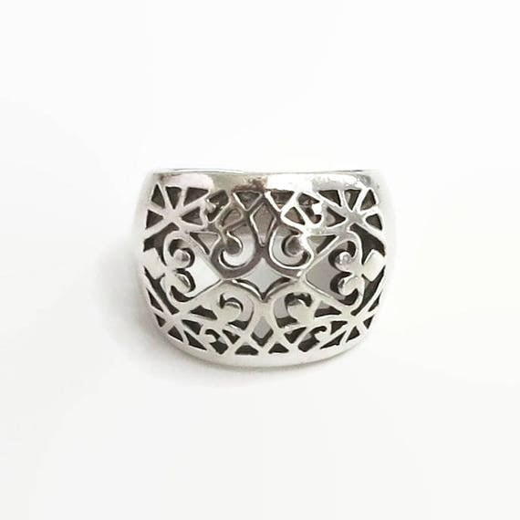 Wide sterling silver band ring with open filigree pattern on front, hearts and other shapes, stamped 925, 8 grams, size N / 6.5