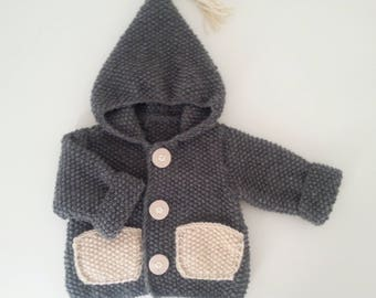 Vest with hood for born baby in 24 months hand-knitted woolen intoxicate(tint) with pockets and beige pompom