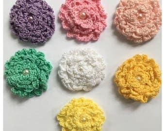 Crochet flowers 2.16 in made with 100% peruvian cotton yarn for accesories   1 flower per bag.