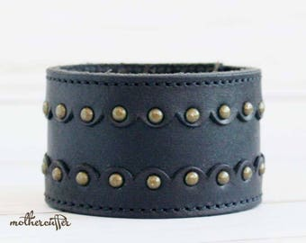 CUSTOM HANDSTAMPED wide black leather cuff with rivets by mothercuffer