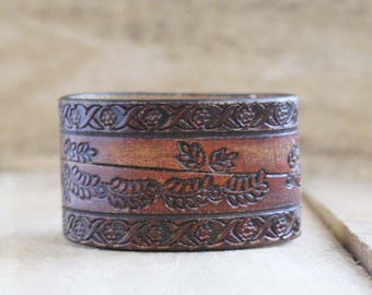 CUSTOM HANDSTAMPED distressed brown leather cuff with flower design by mothercuffer