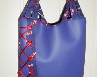 thick blue/purple leather handbag