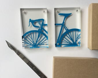 Handcut front/back of a bike protected in a mini acrylic frame
