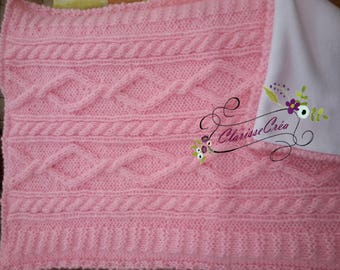 little knitted baby blanket and fleece