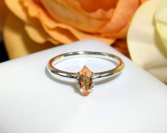 Genuine, Untreated, Ouro Preto, Brazil, Imperial Topaz, Sterling Silver Ring, U.S. Size 5.5. Oval, Facet. Vivid Color: Golden Yellow Orange.