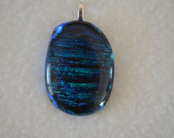 Glass pendant with green and blue lines