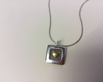 Beautiful little pendant of Fine silver and 22 carat accent gold.