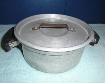 Vintage pan. vintage cookware. Vintage pot. Pan with lid.