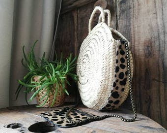 Round basket with leather Cheetah detail, has a removable chain.