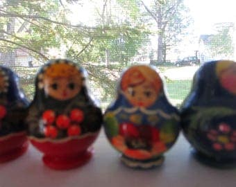 Set of Four Handpainted Vintage Tiny Nesting Dolls