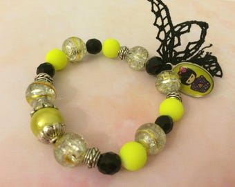 romantic love d yellow bracelet and its Japanese doll