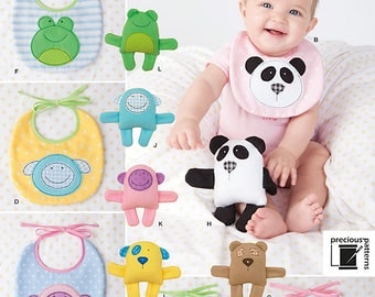 Simplicity 1904 Baby Bibs and Stuffed Animals. One Size. Pattern is new and uncut.