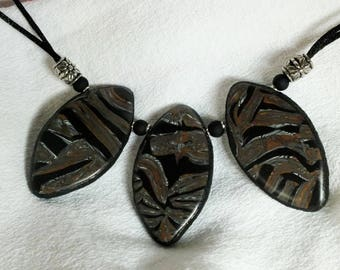 Necklace made of three abstract patterns