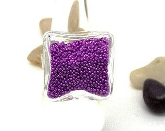 Ring cubic globe filled with purple microbeads
