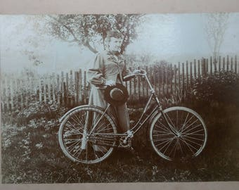 Antique large photo of a Victorian woman and her bicycle