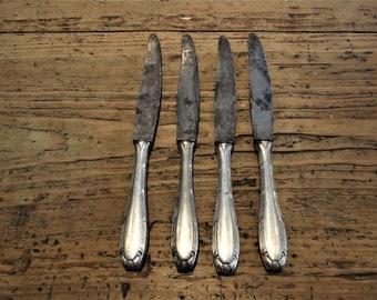 Vintage set of 4 Metal Knives