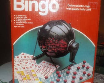 Vintage (c. mid 1980s) Playtoy Industries Bingo game.  Spinner   cage, 75 plastic calling balls and peg board.