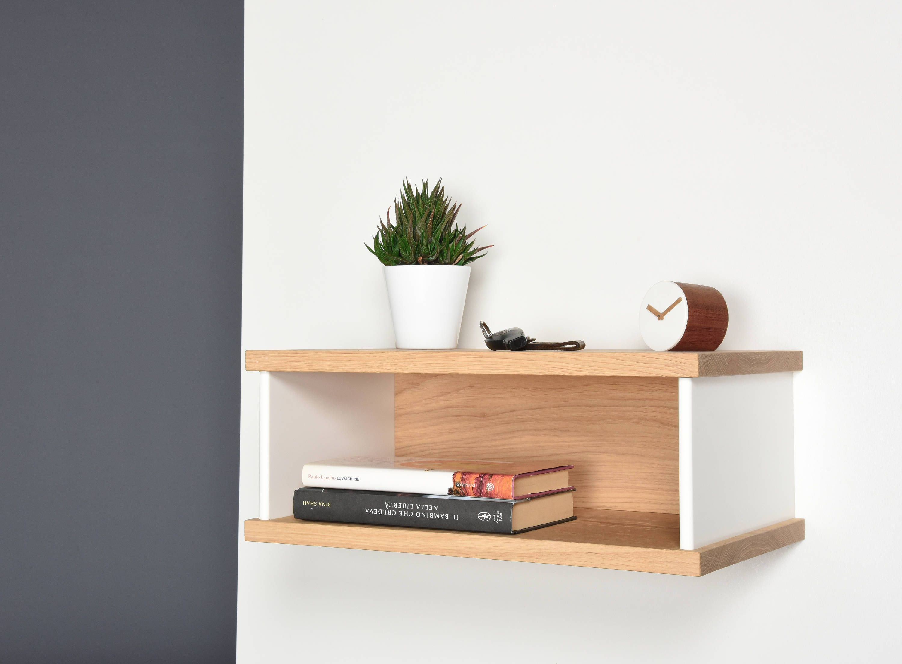 Floating bedside tables in oak and Corian Bedside suspended
