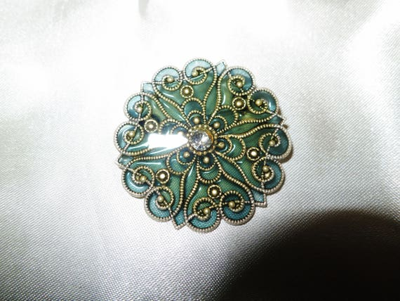 Beautiful vintage silvertone  Deco style green stained glass rhinestone brooch