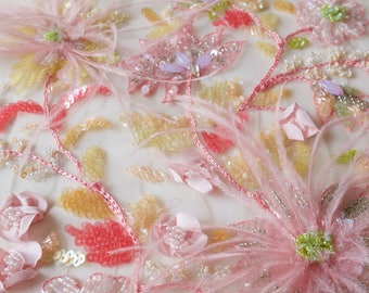 Tulle hand-embroidered in bright pastels with beads, sequins and ostrich feathers