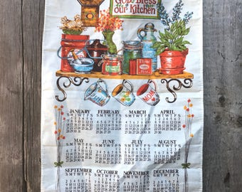 "1979 ""God Bless Our Kitchen"" calendar towel"