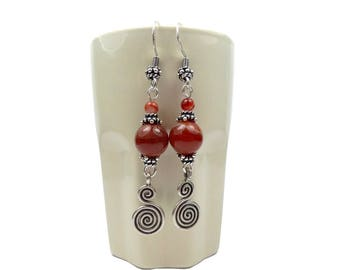 Earrings in silver and orange agate, dangling double spirals, ethnic