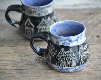Tiny little houses on black background blue patchwork handmade pottery mug