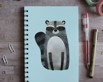 NOTEBOOK. A5 Cute Raccoon Spiral Notebook. Soft 300 gsm Card Cover. 120 lined pages. Matte lamination pleasant to the touch.