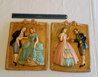 """set of two antique chalkware plaques 8""""x11"""" wall hanging romantic couple hand painted 3d design  art deco plaster man woman pottery figures"""