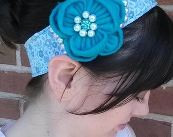blue felt flower with blue and white beading on blue/white headband
