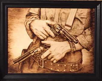 Handmade wood burning of a Western Gunman