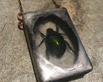 Hand Made Victorian Steampunk Style Pendant, With Distressed Butterfly, Bird Skull & Resin Cast Bug / Beetle With Iridescent Green Body