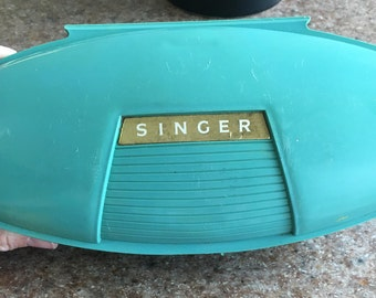 Singer button hole maker