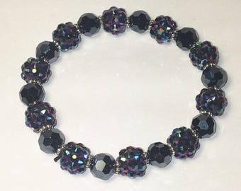 Navy blue sparkly stretch bracelet with silver accent beads. Stretchy One Size