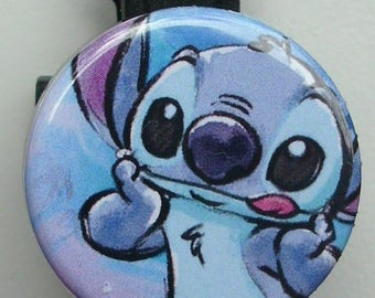 Stitch illustration with tongue sticking out badge reel