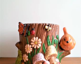 Vintage ceramic tree stump planter with critters