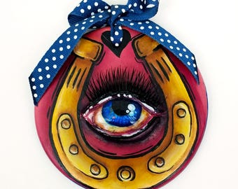 Lucky painted ceramic round ornament with horseshoe and eye