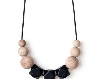 Beckett symmetrical teething necklace, black silicone BPA free beads, untreated wood.Sensory,fiddling, breastfeeding, babywearing.