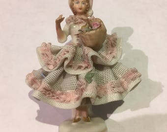 Little Vintage Dresden porcelain lace figurine - lady with a flower basket. Collectable hand-painted fine china figurine.